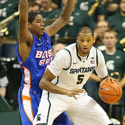 Michigan State center Adreian Payne, shown posting up against Kenny Buckner here, contributes 10 points on 5-of-6 shooting.  (US Presswire)
