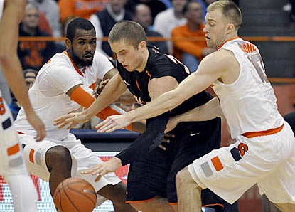 Princeton's Ian Hummer (center) is pressured by Syracuse's James Southerland (left) and Trevor Cooney during the first half.  (AP)