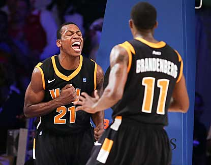VCU's Treveon Graham (21) and Rob Brandenberg combine for 11 straight points late in the VCU win. (US Presswire)