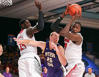 Louisville center Gorgui Dieng, right, battles for a rebound with Northern Iowa's Jake Koch. (US Presswire)