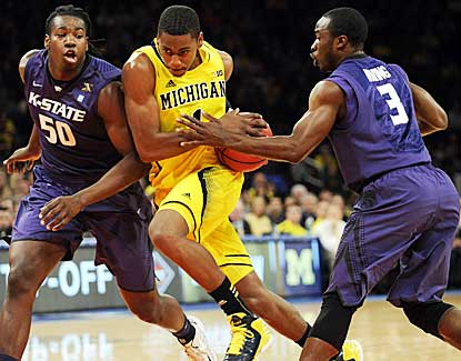Michigan's Glenn Robinson III drives to the hoop against KSU's D.J. Johnson, left, and Martavious Irving. (AP)