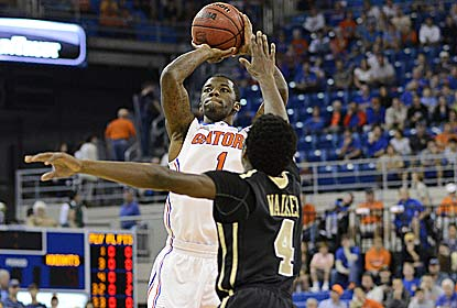 Kenny Boynton, three days after spraining his left ankle, goes 7 for 15  en route to a season-high 24 points for UF. (AP)