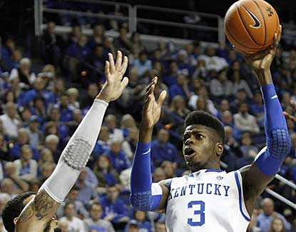 Kentucky center Nerlens Noel puts up a shot over LIU Brooklyn's Julian Boyd in the Wildcat victory. (AP)