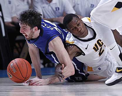 Duke forward Ryan Kelly scraps for a loose ball with VCU's Treveon Graham on Friday in the Bahamas. (AP)