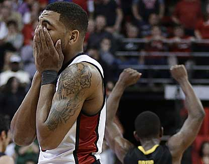 UNLV's Anthony Marshall covers his face after missing a layup late in the Rebels' loss to Oregon. (AP)