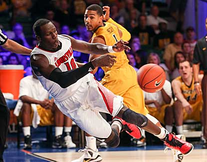 Louisville center Gorgui Dieng saves a loose ball in the Cardinals' win over Missouri. (US Presswire)
