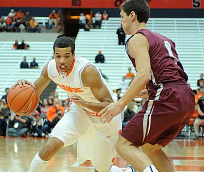 Syracuse guard Michael Carter-Williams looks for driving room as Colgate's Luke Roh defends Sunday at the Carrier Dome.  (US Presswire)