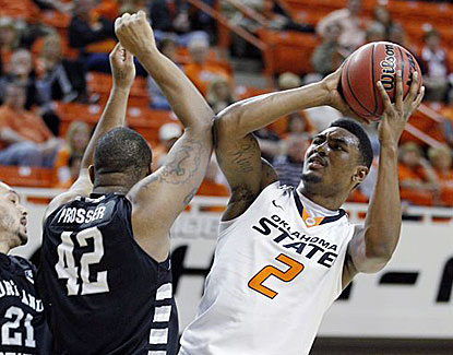 Oklahoma State guard Le'Bryan Nash scores 20 points for the Cowboys, continuing his solid play this season.  (AP)