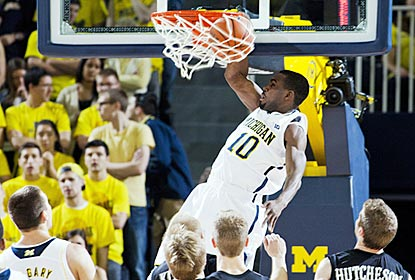 Tim Hardaway Jr. dunks to help spark the Wolverines after Michigan's slow start to the first half.  (AP)