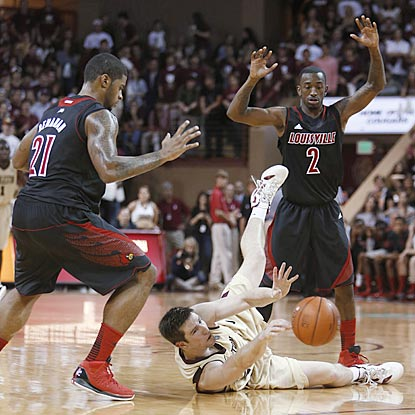 College of Charleston's Willis Hall has a little trouble trying to break Louisville's full-court press during the first half.  (AP)