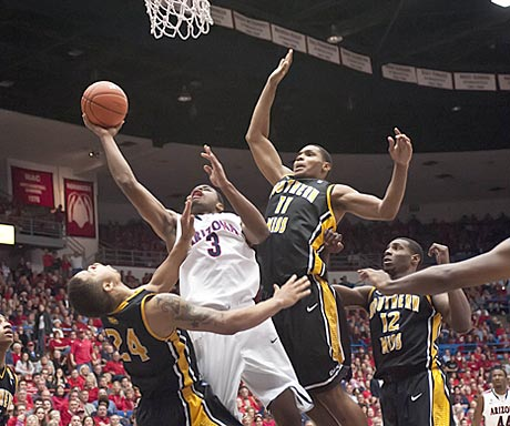 Arizona senior Kevin Parrom drives through the Southern Mississippi defense during the second half.  (US Presswire)