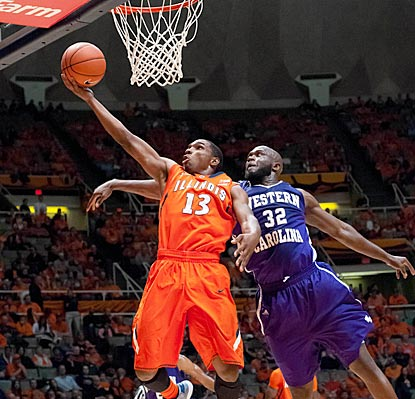 Illinois' Tracy Abrams beats Western Carolina's Tawaski King to the hoop for a layup in the first half.  (US Presswire)