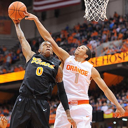 Syracuse's Michael Carter-Williams blocks Kris Gulley's shot and helps limit Long Beach State to 29.2 percent shooting.  (US Presswire)