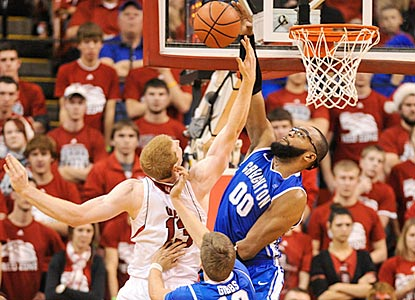 Gregory Echenique rejects Brandon Ubel and helps Creighton hold Nebraska to 22 points below its scoring average.  (Getty Images)
