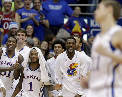 The Jayhawks cheer on reserve Tyler Self (right), who scores on the final play in the blowout over Colorado. (AP)