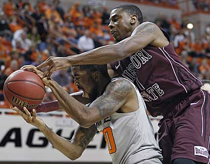 Oklahama State forward Michael Cobbins battles for a rebound with Missouri State's Keith Pickens. (AP)