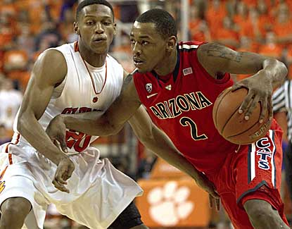 Arizona guard Mark Lyons attempts to drive past Clemson's Jordan Roper on Saturday night. (US Presswire)