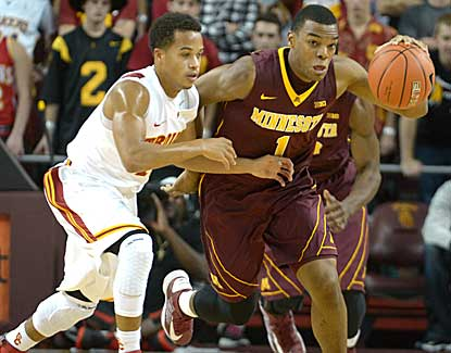 Minnesota guard Andre Hollins works the ball against USC's Chass Bryan on Saturday night. (US Presswire)