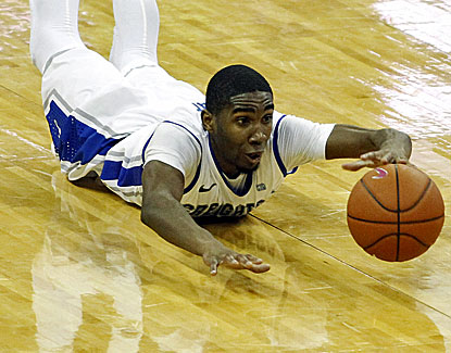 Creighton guard Jahenns Manigat dives for a loose ball against Akron. He also hustles for 2 steals in the game. (US Presswire)