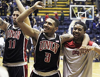 Carlos Lopez-Sosa (11), Anthony Marshall (3) and Daquan Cook celebrate UNLV's dramatic victory.  (AP)