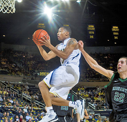 Trey Burke puts up a game-high 19 points to help Michigan improve to 10-0 on the season. (AP)