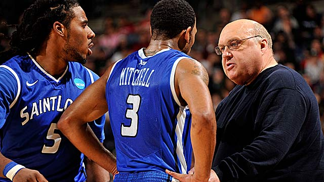 Kwamain Mitchell (center) says Rick Majerus 'made me become a man.' (Getty Images)