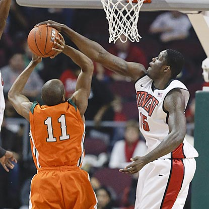 In the first half, UNLV's Anthony Bennett gives La Verne's Alonzo Young (11) a rude introduction to Division I hoops.  (AP)