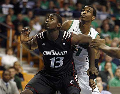 Cincinnati's Cheikh Mbodj boxes out Marshall's Nigel Spikes. Mbodj has four boards and nine points.  (US Presswire)