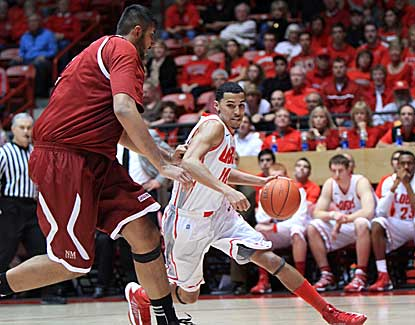 New Mexico's Kendall Williams scores a game-high 15 points to lead the Lobos past New Mexico State. (AP)
