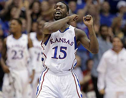 Kansas' Elijah Johnson celebrates a basket for two of his seven points in KU's' win over Belmont. (AP)