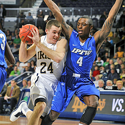 Pat Connaughton (left) scores 18 points to lead No. 22  Notre Dame past IPFW to a 74-62 win. (AP)