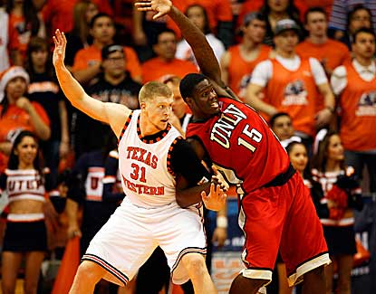 UTEP's Cedrick Lang and UNLV's Anthony Bennett battle for position. Bennett scored 10 points. (US Presswire)