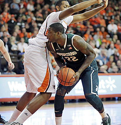 Branden Dawson (right), who scores 10 points and grabs seven boards, drives the lane against Bowling Green's Cameron Black.  (AP)