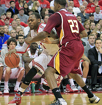 Deshaun Thomas (left) scores 21 points and adds nine rebounds to lead Ohio State past Winthrop. (AP)