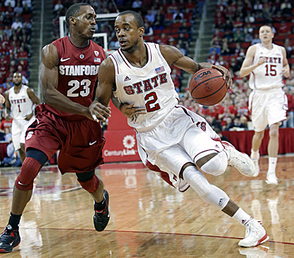 Lorenzo Brown (right), who scores a season-high 24 points in N.C. State's win, drives against Stanford's Gabriel Harris. (AP)