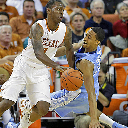 Sheldon McClellan (left), who scores 18 points, drives against UNC's J.P. Tokoto in the Longhorns' win.  (AP)