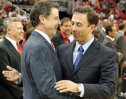 Louisville coach Rick Pitino (left) shares a moment with his son, FIU coach Richard Pitino, prior to tipoff. (Getty Images)