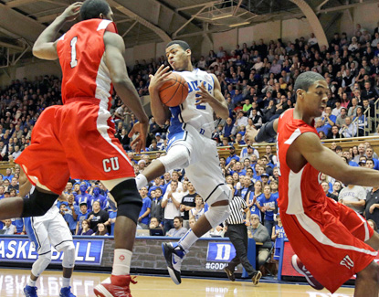 Duke's Quinn Cook (center) dishes out a career-high 12 assists in the Blue Devils' win against Cornell. (AP)