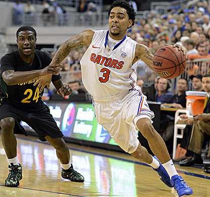Florida's Mike Rosario drives to the basket for two of his season-high 20 points. (AP)