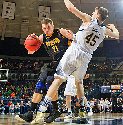 Kennesaw State's Aaron Anderson tries to get around Notre Dame's Jack Cooley, who finishes with a double-double. (US Presswire)
