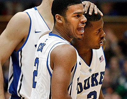 Duke guards Quinn Cook (2) and Tyler Thornton combine for 18 points and 7 assists against Elon. (US Presswire)