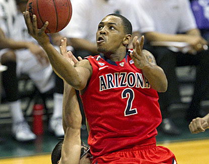 Arizona guard Mark Lyons doesn't shoot the ball well, but he does contribute 4 assists. (AP)
