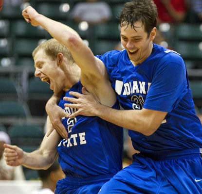 Indiana State celebrates a dramatic Christmas Day victory over Miami at the Diamond Head Classic.  (AP)
