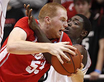 New Mexico's Alex Kirk (53) scores 15 with a crucial block late in the Lobos' win at Cincinnati. (US Presswire)