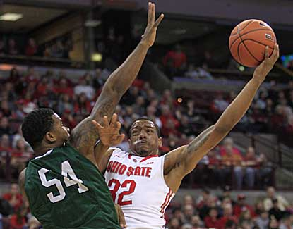 Ohio State guard Lenzelle Smith puts up a shot over CSU's Markus Starks on his way to 13 points. (AP)