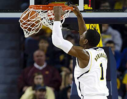Michigan's Glenn Robinson flushes the dunk for two of his 20 points against Central Michigan. (US Presswire)