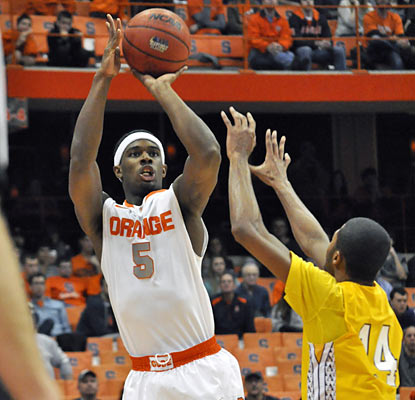 Syracuse forward C.J. Fair scores a team-high 13 points on 6 of 12 shooting from the field. (AP)
