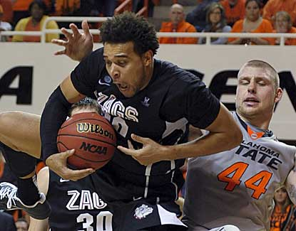 Gonzaga forward Elias Harris leaps in front of OSU's Philip Jurick for a rebound. (AP)