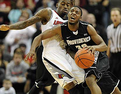 Providence guard Vincent Council tries to drive past Russ Smith, who scores a game-high 23 points. (US Presswire)