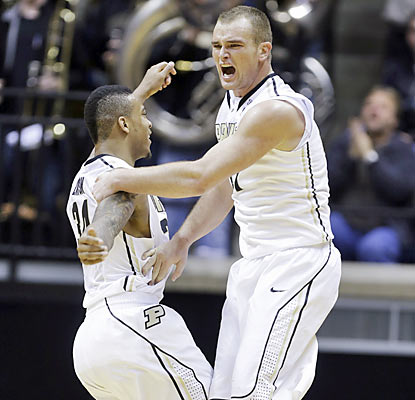 D.J. Byrd (right) scores nine of his 15 points during a crucial Purdue run in the second half. (AP)